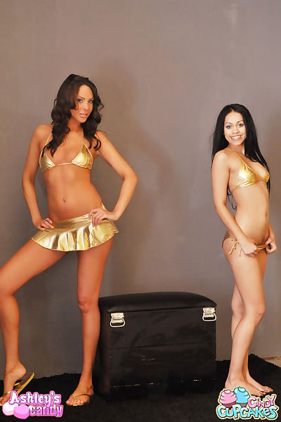 Two hotties in shiny gold..